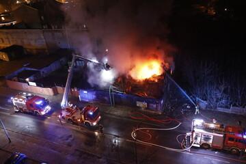 Fototapeta Fire fighting at night by firefighters obraz