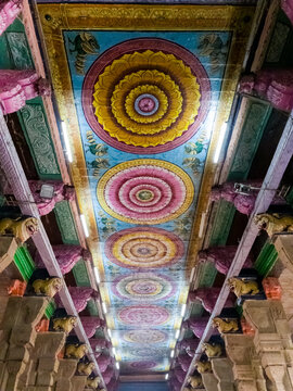 Colorfully painted ceiling of the ancient Hindu temple of Meenakshi Amman in Madurai.