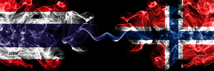 Thailand, Thai vs Norway, Norwegian smoky mystic flags placed side by side. Thick colored silky abstract smokes flags.