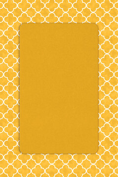 Blank yellow invitation mockup with a frame and quatrefoil design