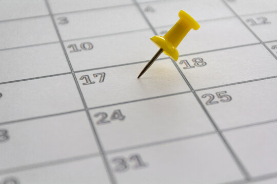 Calendar with pushpin in May 17 to illustrate the new extended date for IRS Federal Income Tax Returns. USA Tax deadline concept