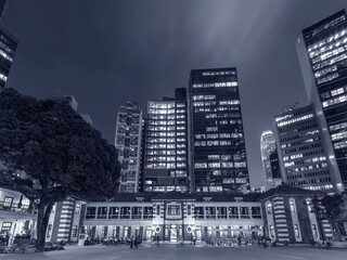 Fototapete - Night scenery of old and modern high rise buildings in Hong Kong city