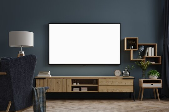 Mockup tv on cabinet in modern empty room at night with behind the dark blue wall.