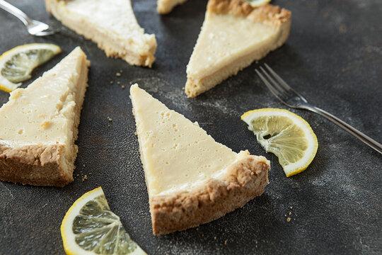 appetizing lemon pie on a dark background, lemon cheesecake
