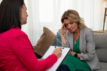 Obraz Thoughtful woman during psychotherapy session - fototapety do salonu