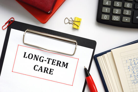 Financial concept about LONG-TERM CARE with sign on the piece of paper.
