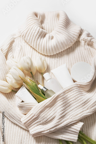Flat lay flowers and cosmetics. Happy Mother's Day, top view stylish female and spring concept. Blog hero header background. Gift for women. Natural care cosmetics and spa