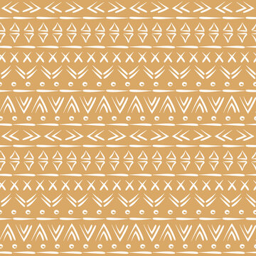 Sand brown and white boho mud cloth design. Tribal motifs. Trendy bohemian style background print. Seamless pattern vector.
