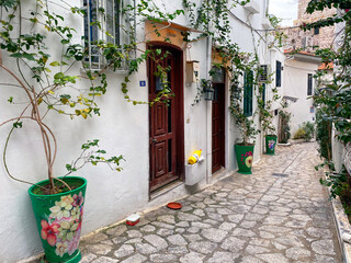 Beautiful Streets of old Marmaris. Narrow streets with stairs among the houses with white brick, green plants and flowers in the old town of resort of in Turkey