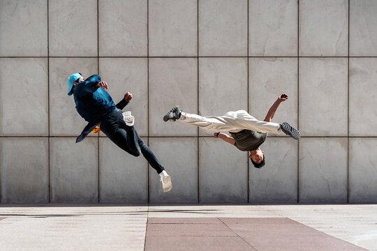 Casual Young Men Break Dancing