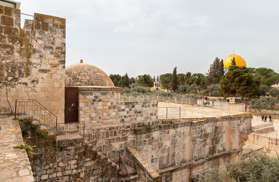 View from the wall encircling the Temple Mount near the closed Golden Gate - Gate of Mercy, of the Dome of the Rock mosque in the Old Town of Jerusalem in Israel