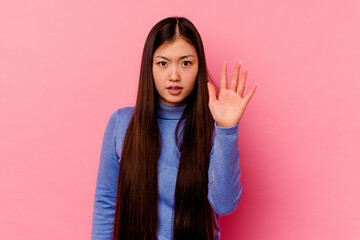 Fototapeta Young chinese woman isolated on pink background being shocked due to an imminent danger