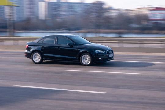 Ukraine, Kyiv - 21 March 2021: Black Audi A3 car moving on the street. Editorial