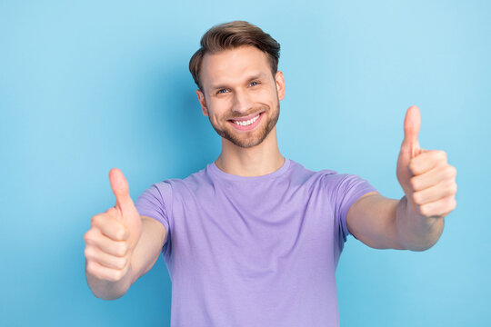 Photo portrait of man showing thumb-up sign like isolated on pastel blue color background