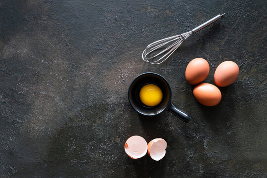 Yolks and egg protein in a black cup.
