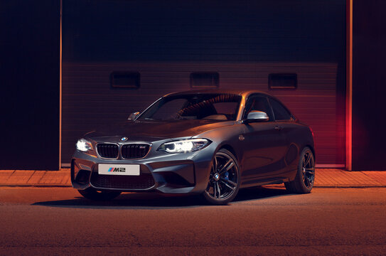 Santander, Spain - April 4, 2021: The BMW 2 Series is a high-end sports car from the German manufacturer BMW. In the image gray BMW M2 seen from the front.