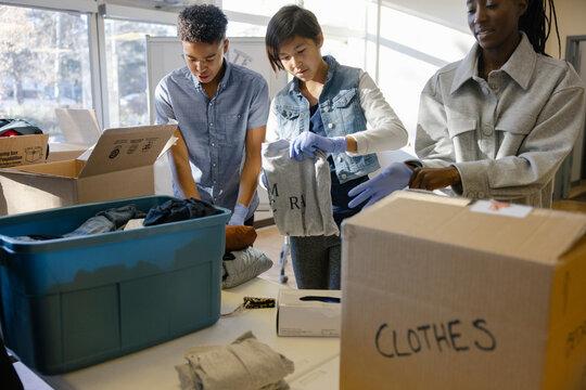 Volunteers sorting donations in community center