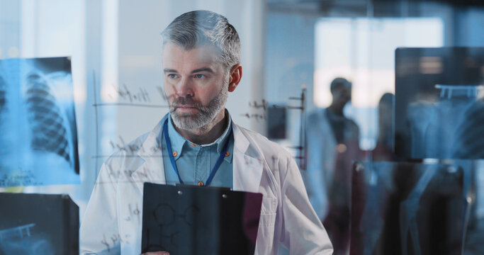 Portrait of Handsome Caucasian Doctor Wearing Laboratory Coat Doing Busy Work in Office Hospital. Doctor Concept.