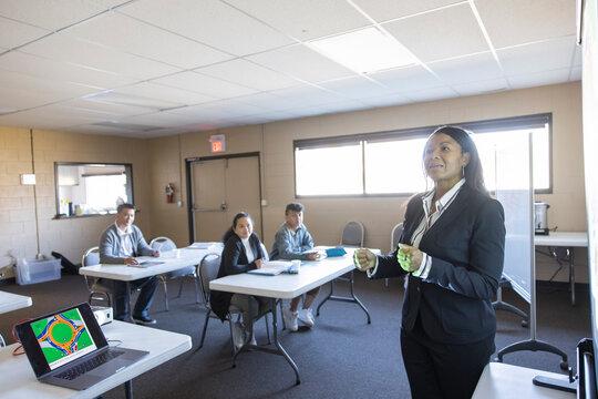 Driver education teacher leading lesson in community center classroom