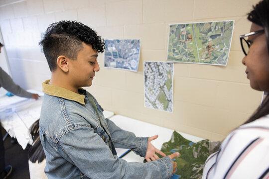 Young man talking in urban planning meeting