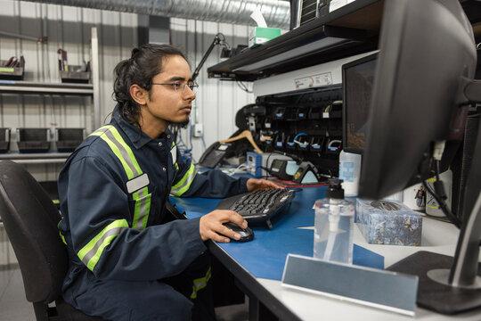 Technician using computer in workshop