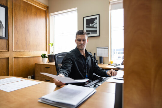 Man looking at paperwork in office