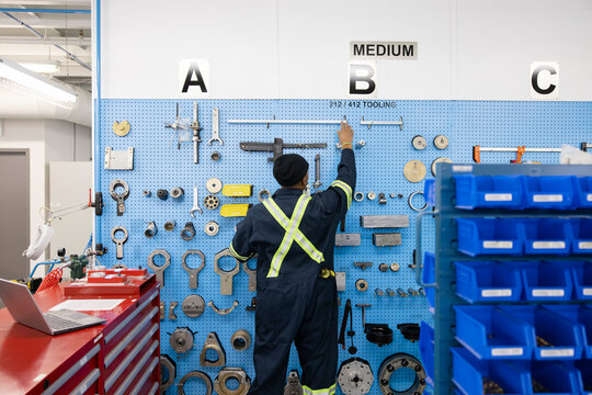 Technician selecting components in storeroom