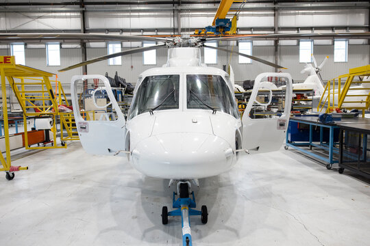 Helicopter being assembled in hangar