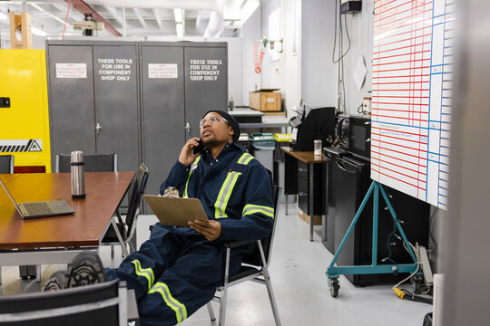 Technician on phone in meeting room