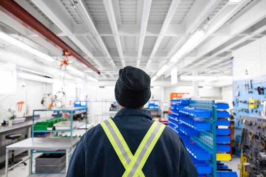 Technician walking through workshop in hangar