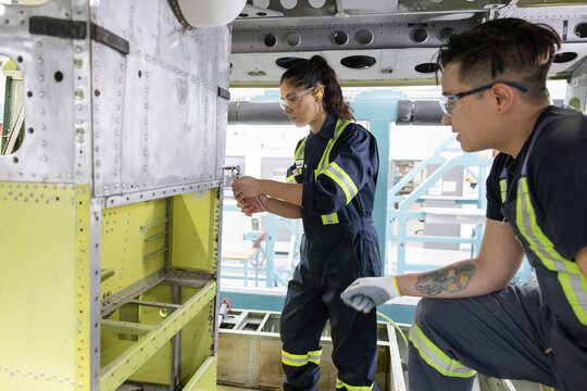 Technicians working on helicopter interior