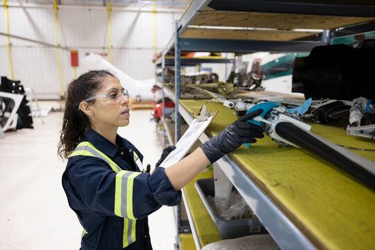 Engineer finding helicopter part in storeroom
