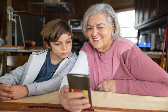 Grandmother and grandson looking at phone