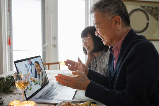 Grandfather clapping hands on video call with granddaughter