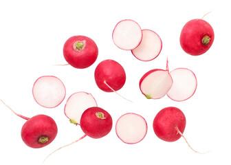 Fototapeta Fresh whole radish and pieces are flying on a white background, radish levitating. Isolated obraz