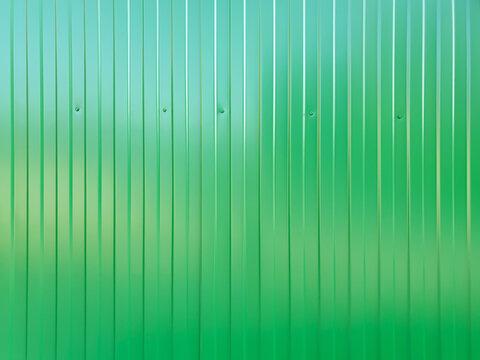 Green metal sheet profile surface, texture. Top view