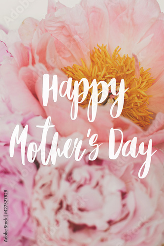 Happy mother's day. Happy mother's day text on beautiful peonies bouquet, pink peony flowers. Stylish floral greeting card. Handwritten lettering. Mothers day