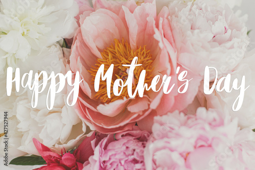 Happy mother's day. Happy mother's day text on beautiful peonies bouquet, pink and white peony flowers. Stylish floral greeting card. Handwritten lettering. Mothers day