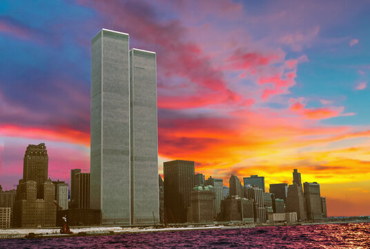 landmark of the Twin Towers at colorful sunset sky. Archival and historical cityscape of New York skyline from New Jersey. Lower Manhattan in NYC, United States.