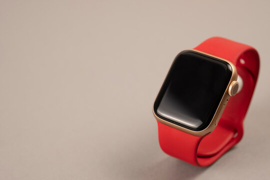 Minsk, Belarus - April 12, 2021: Apple Watch with red silicone strap. Copy space