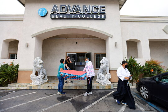 Six degree black belt aikido instructor Tam Ha leaves after teaching self-defense to students at Advance Beauty College during the outbreak of the coronavirus disease (COVID-19) in Garden Grove