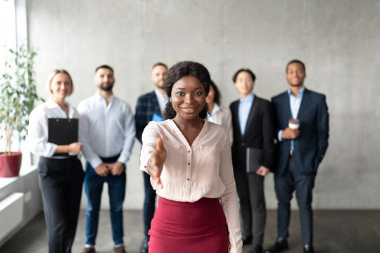 Black Business Lady Stretching Hand For Handshake In Office