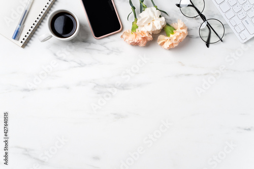 Design concept of Mother's Day greeting with carnation flower on office table.