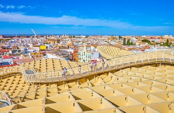 Walk on Metropol Parasol construction in Seville, Spain