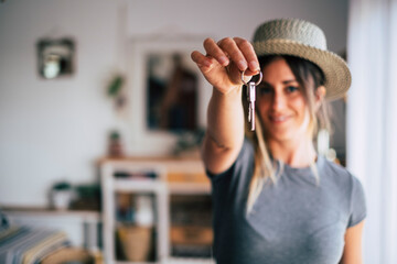 Obraz Crop close up of female tenant renter show praise house keys moving to first own new apartment or house, happy woman owner buy purchase home, relocate to dwelling, rental, rent, ownership concept - fototapety do salonu
