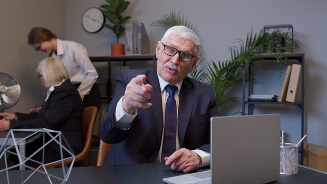 Senior mature old business man pointing to camera, choosing lucky one winner, meaning we need you, showing direction, noticing. Coworking, cooperation. Freelance business. Are you ready, yes you