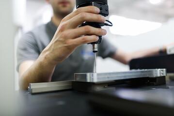 Fototapeta Man Working On Coordinate Measuring Machines.
