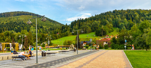 Panoramic view of St. Jacob square, plac Sw. Jakuba, in Szczyrk mountain resort of Beskidy Mountains in Silesia region of Poland