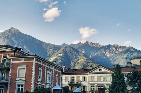 Residential Buildings By Mountains Against Sky