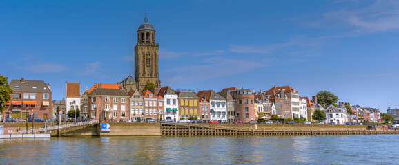 Fototapeta Deventer, The Netherlands - August 27 2016: Dutch city Deventer  skyline panorama view with the Great Church of Lebuines along side the IJssel river
